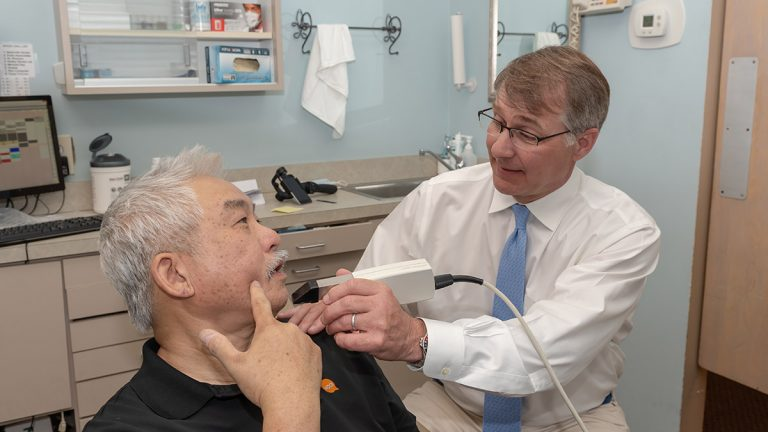 Dr. Fleming using Intraoral Camera with patient